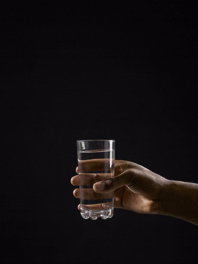 Person holding a glass of water : Stock Photo