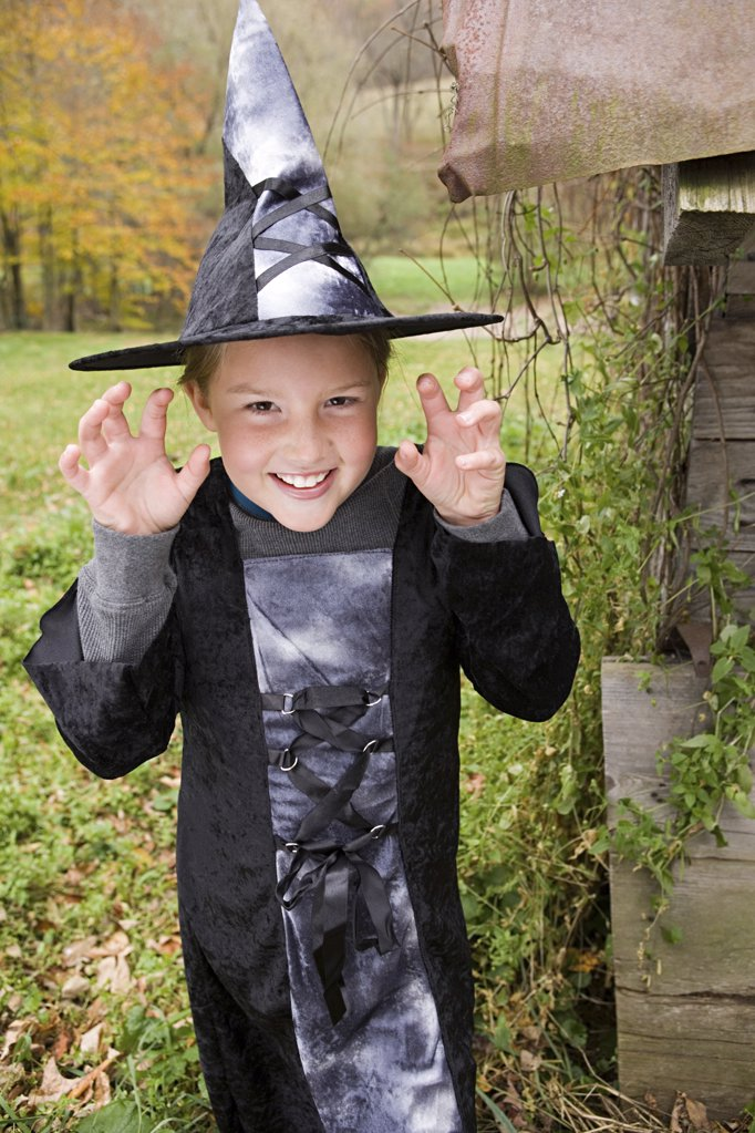 Girl dressed as a witch : Stock Photo