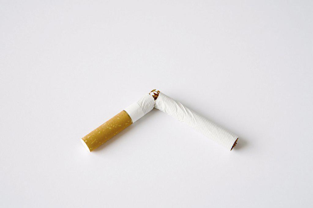 Stock Photo: 1439R-1036064 Broken cigarette