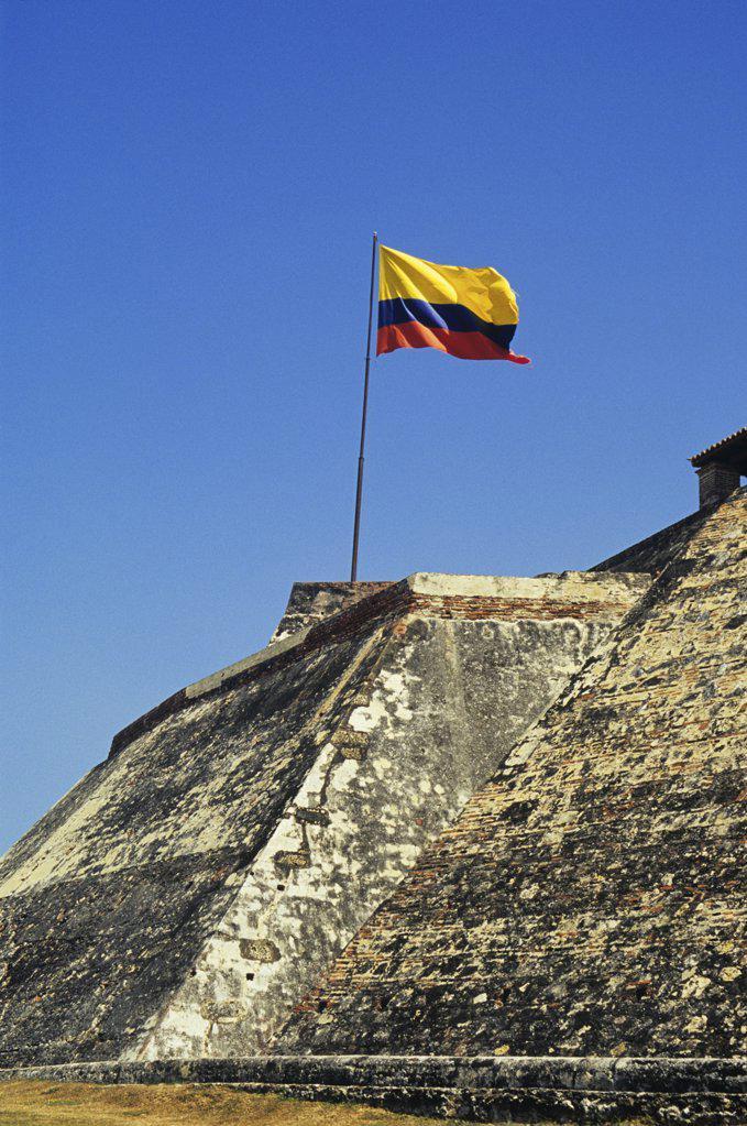 Flag at san felipe fortress cartagena : Stock Photo