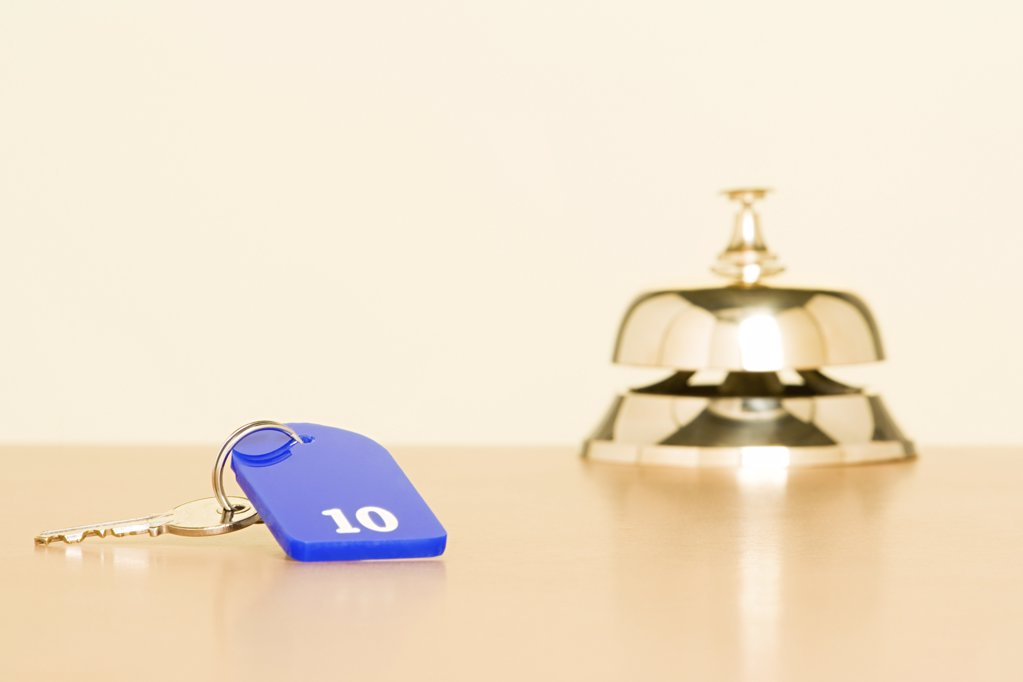 Key and counter bell at hotel : Stock Photo