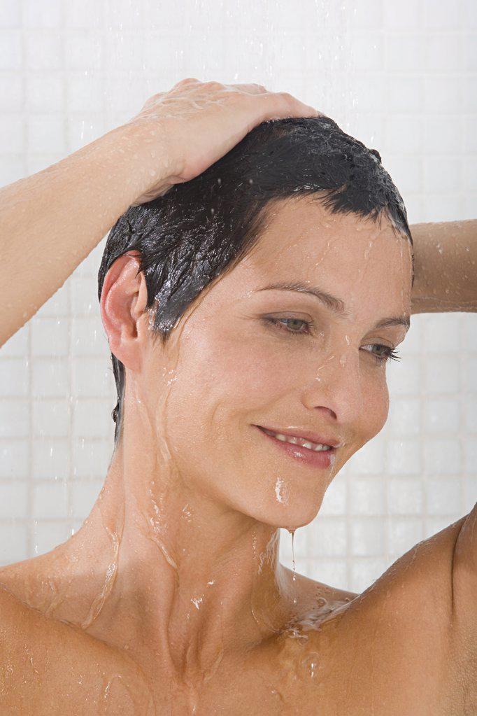 Woman showering : Stock Photo
