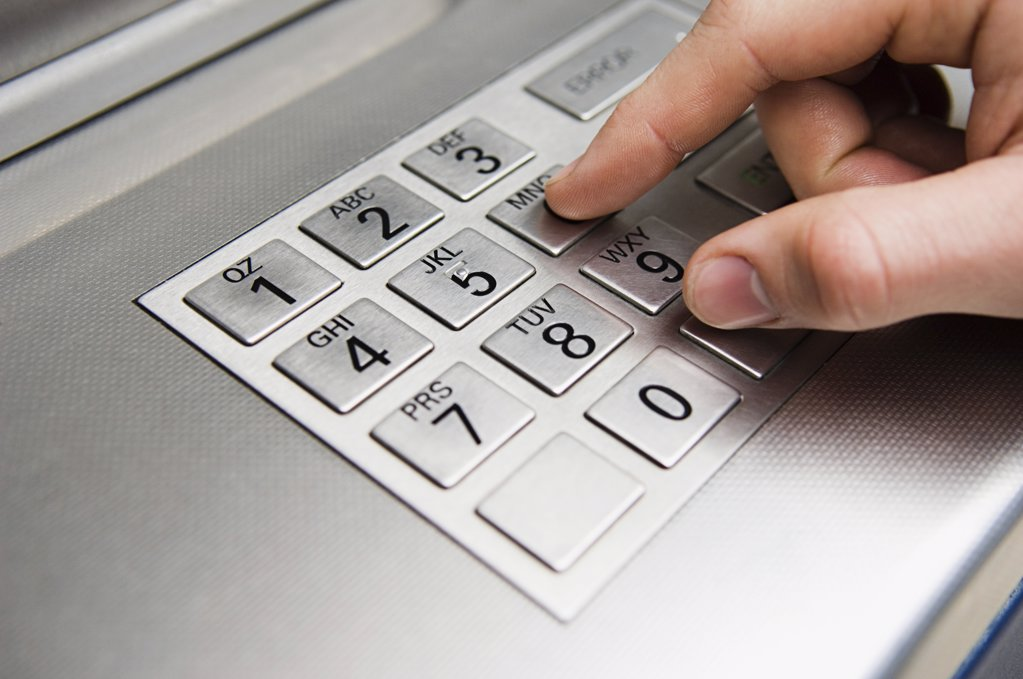 Stock Photo: 1439R-1050001 Person pressing cash machine keypad