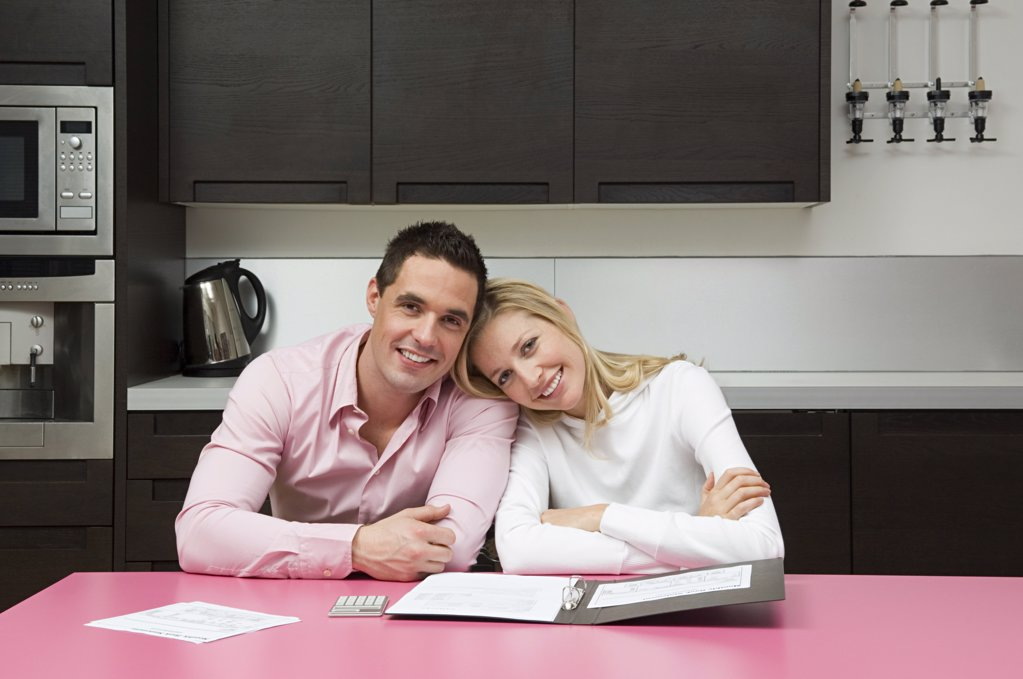 Couple with bank statements : Stock Photo