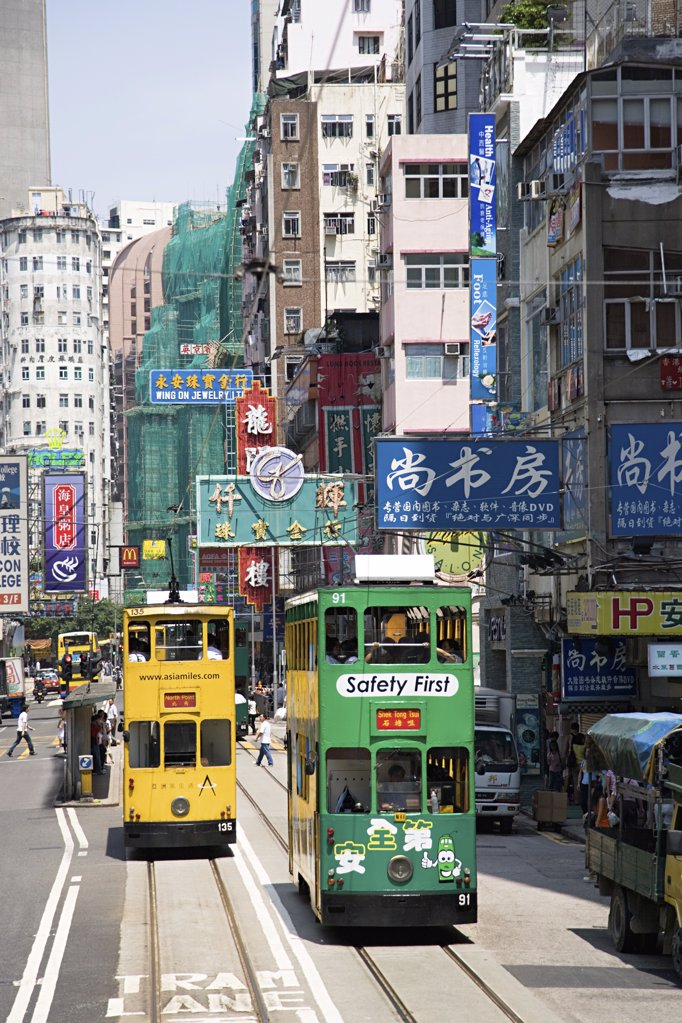Trams on a hong kong street : Stock Photo
