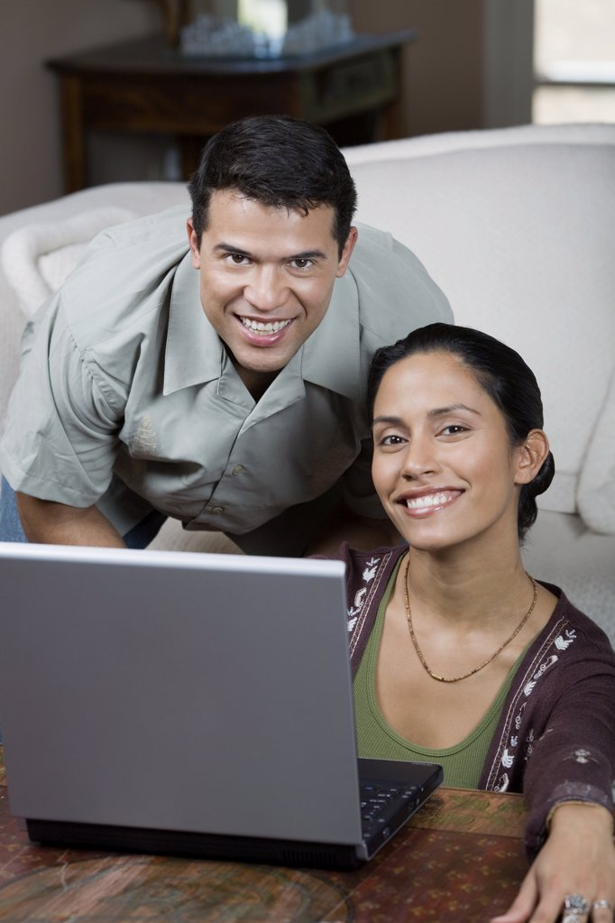 Man and woman with laptop : Stock Photo