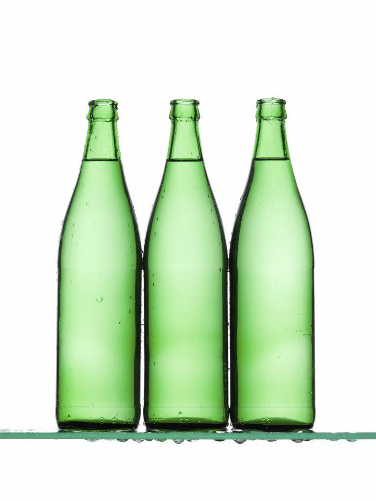 Three green bottles : Stock Photo