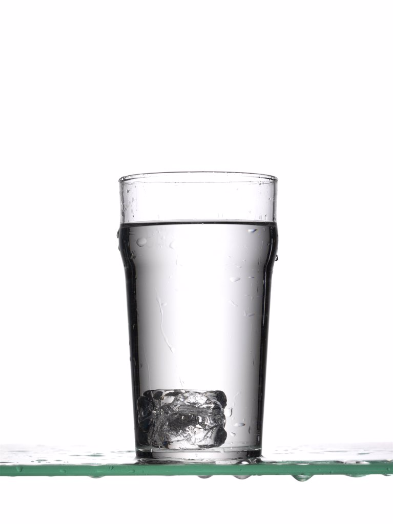 Ice cube in glass of water : Stock Photo