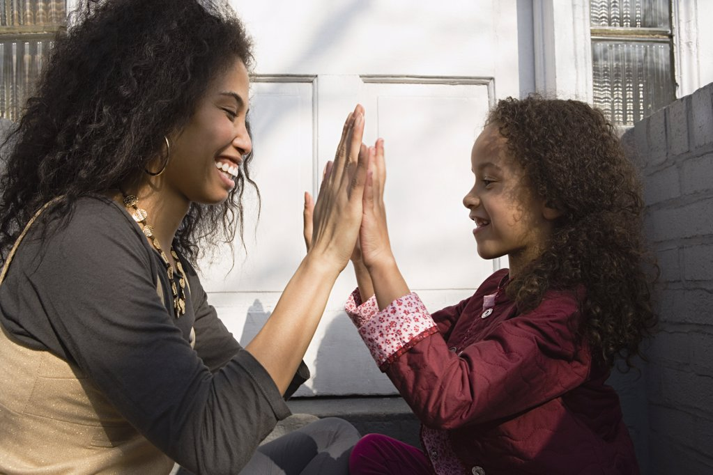 Mother and daughter playing : Stock Photo