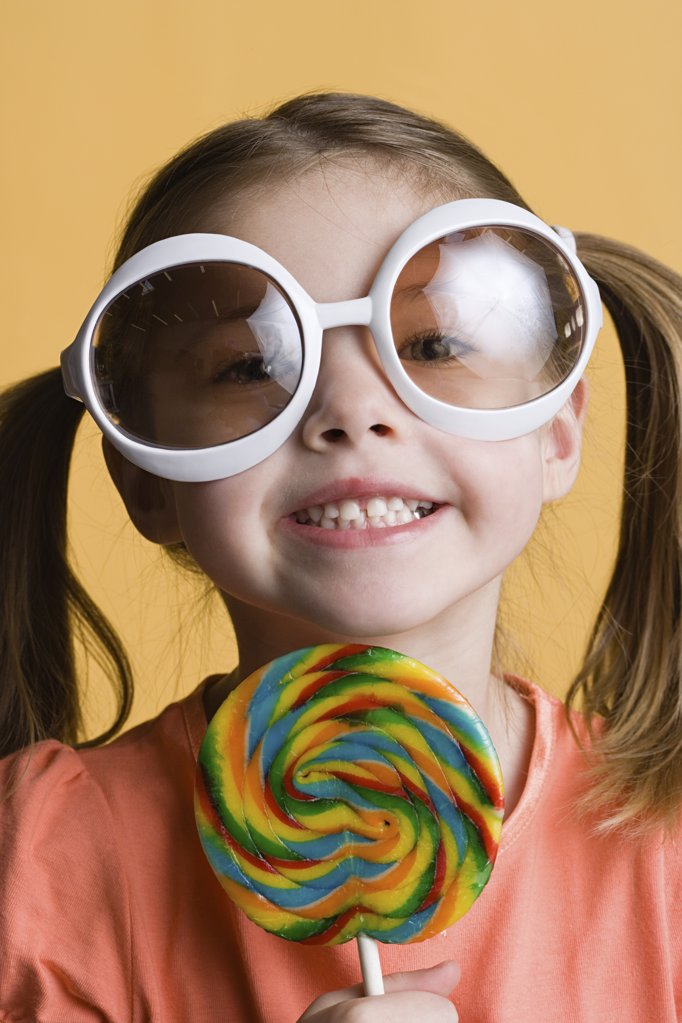 Girl with lollipop and big sunglasses : Stock Photo