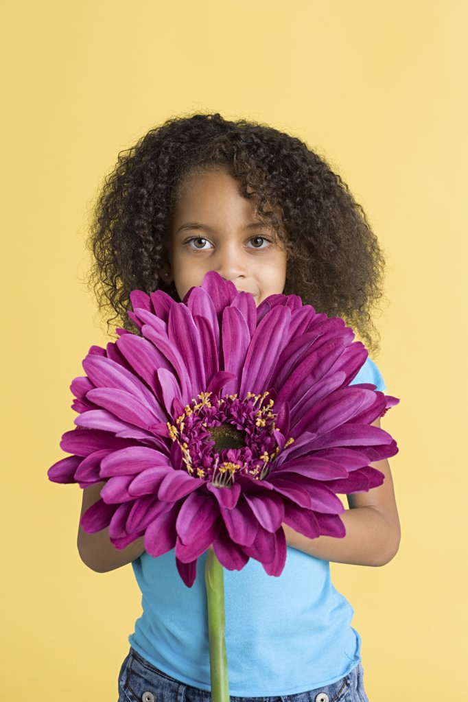 Girl with a big flower : Stock Photo