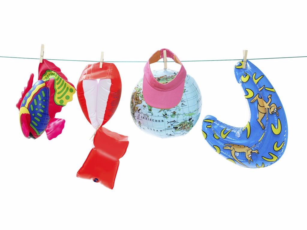 Stock Photo: 1439R-1055059 Inflatable toys on washing line