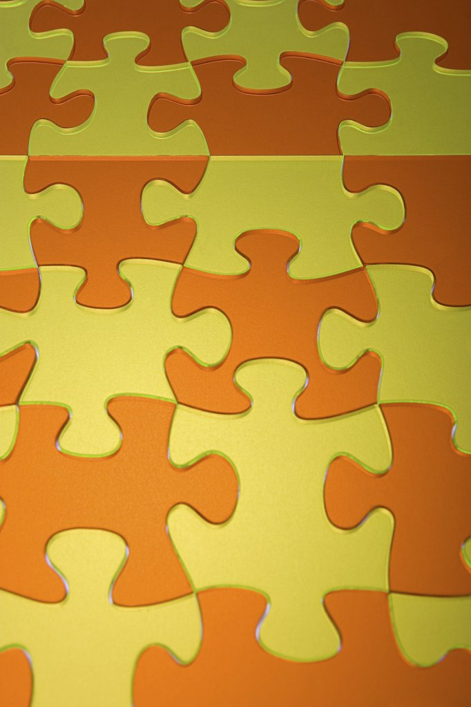 Stock Photo: 1439R-1055165 Orange and yellow jigsaw pieces