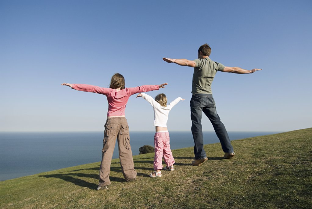 People standing on edge of hill : Stock Photo
