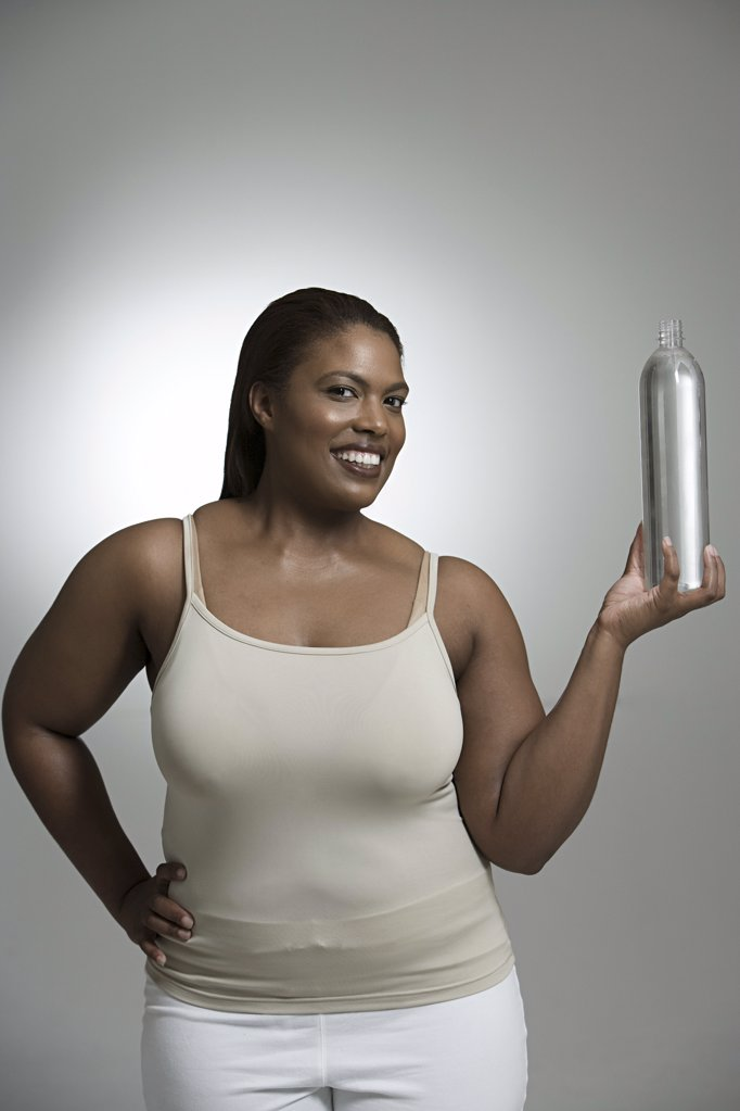 Woman with bottle of water : Stock Photo