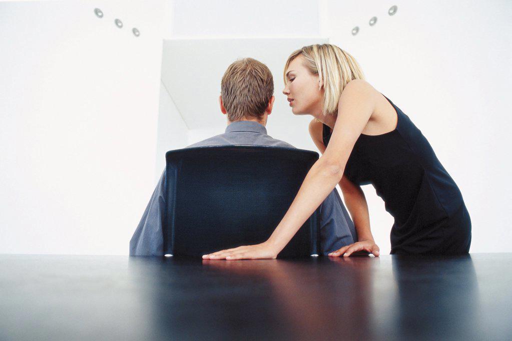 Stock Photo: 1439R-107003 Businessman and businesswoman flirting