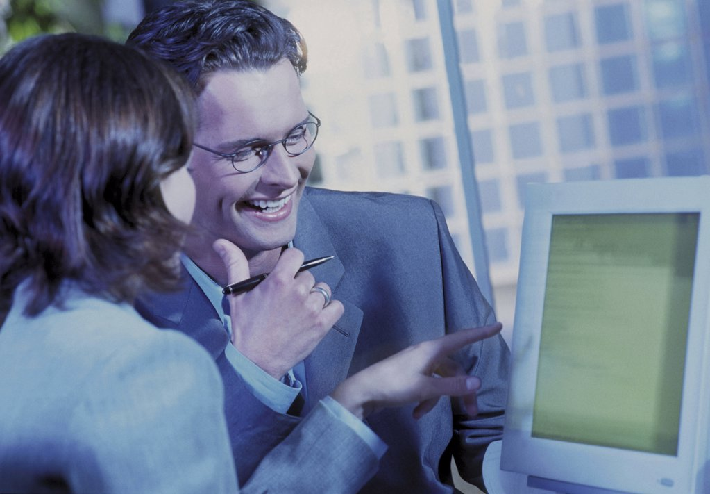 Business couple in office : Stock Photo