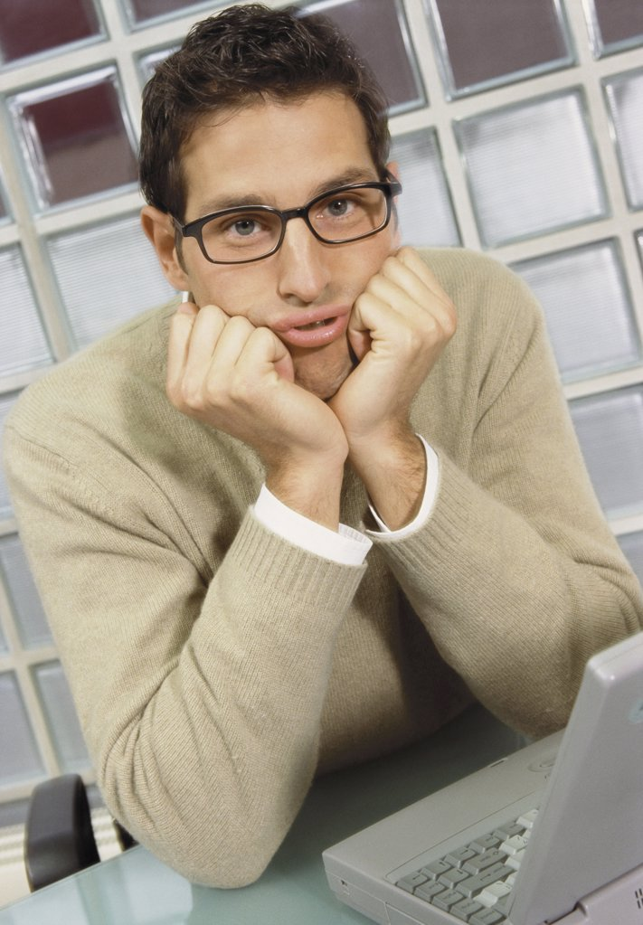 Bored looking businessman : Stock Photo