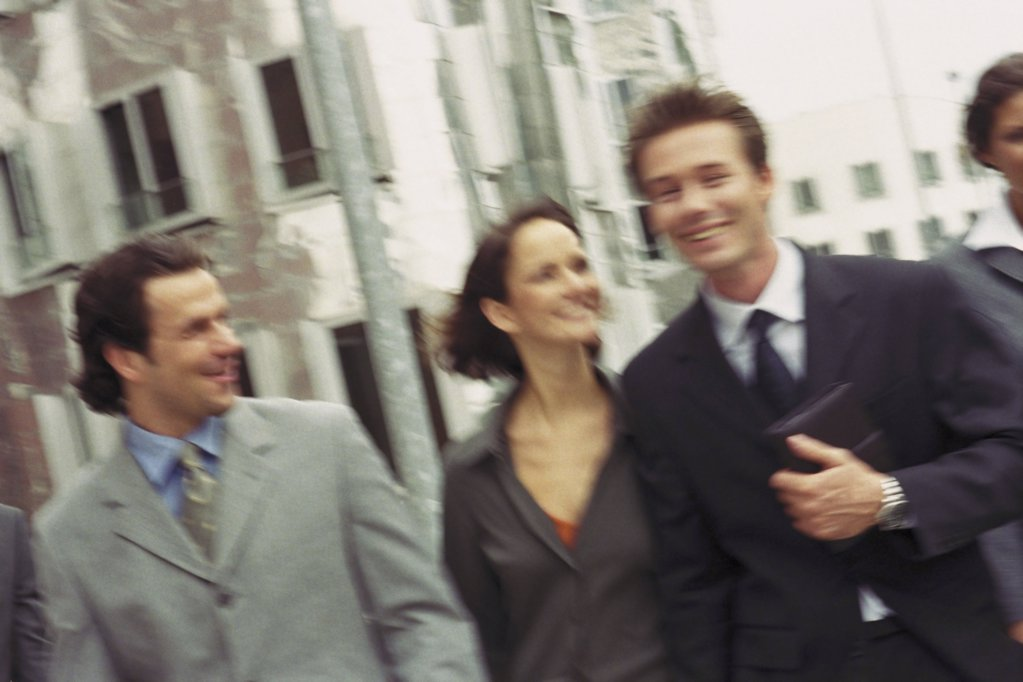Stock Photo: 1439R-1072142 Blurred businesspeople