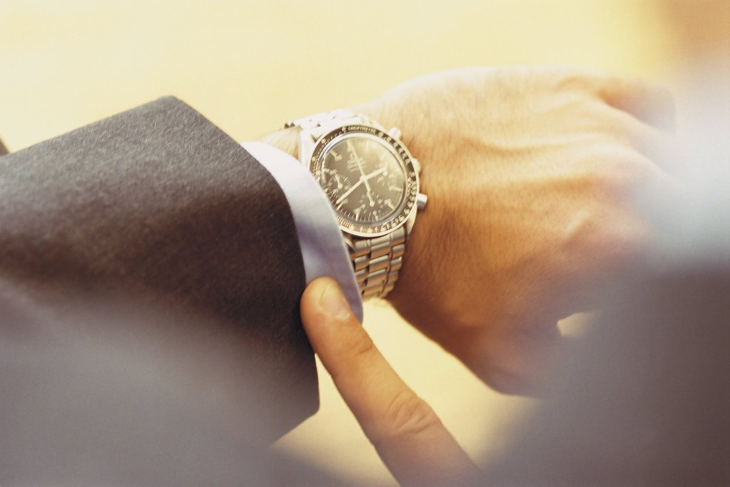 Man looking at time : Stock Photo