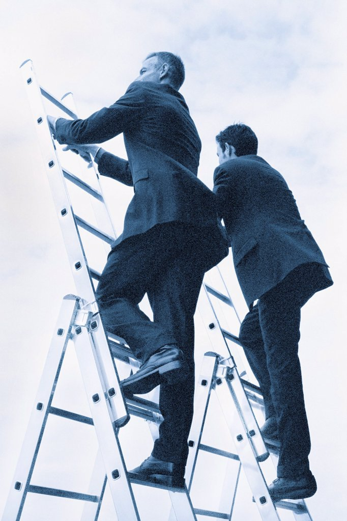 Climbing the ladder : Stock Photo