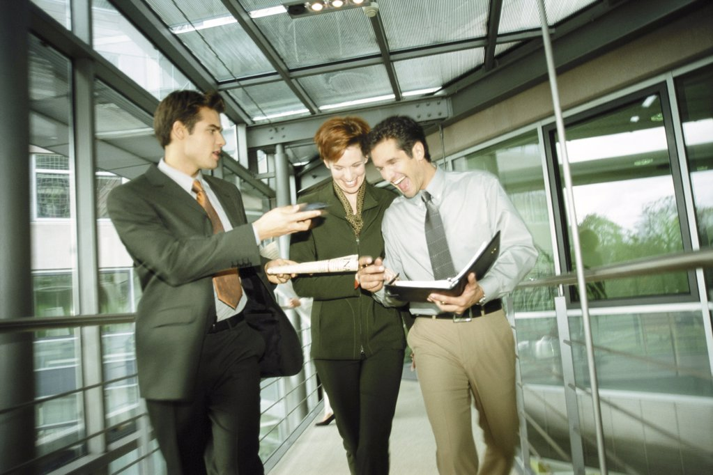 Business people in corridor : Stock Photo