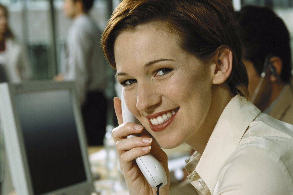 Stock Photo: 1439R-1072399 Woman in call centre