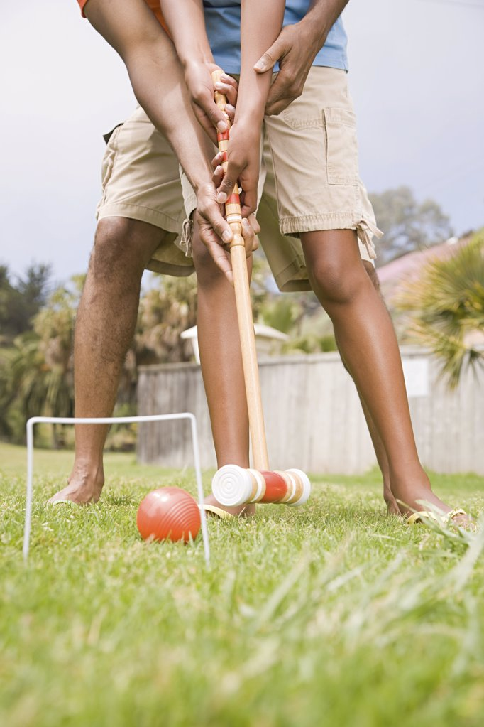Two people playing croquet : Stock Photo