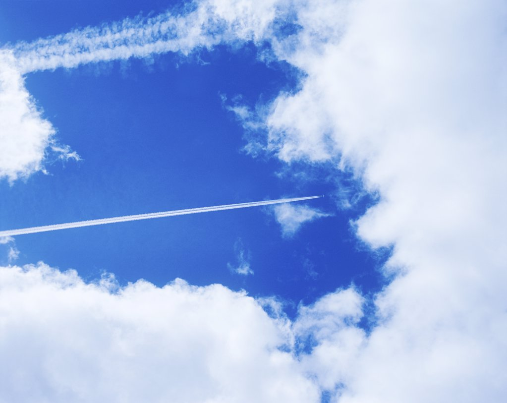 Stock Photo: 1439R-1078151 An aeroplanes vapour trail in the sky
