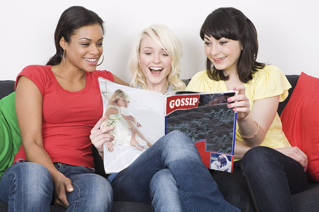 Friends reading a magazine : Stock Photo