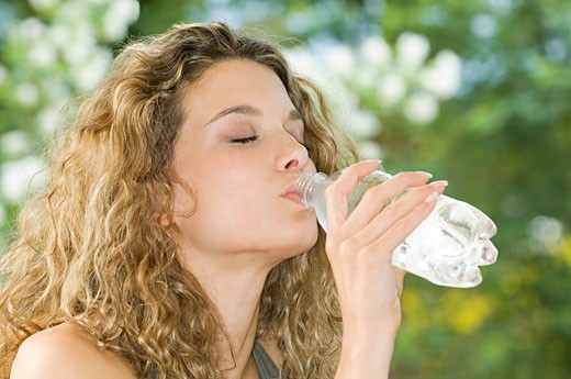 A woman drinking water : Stock Photo
