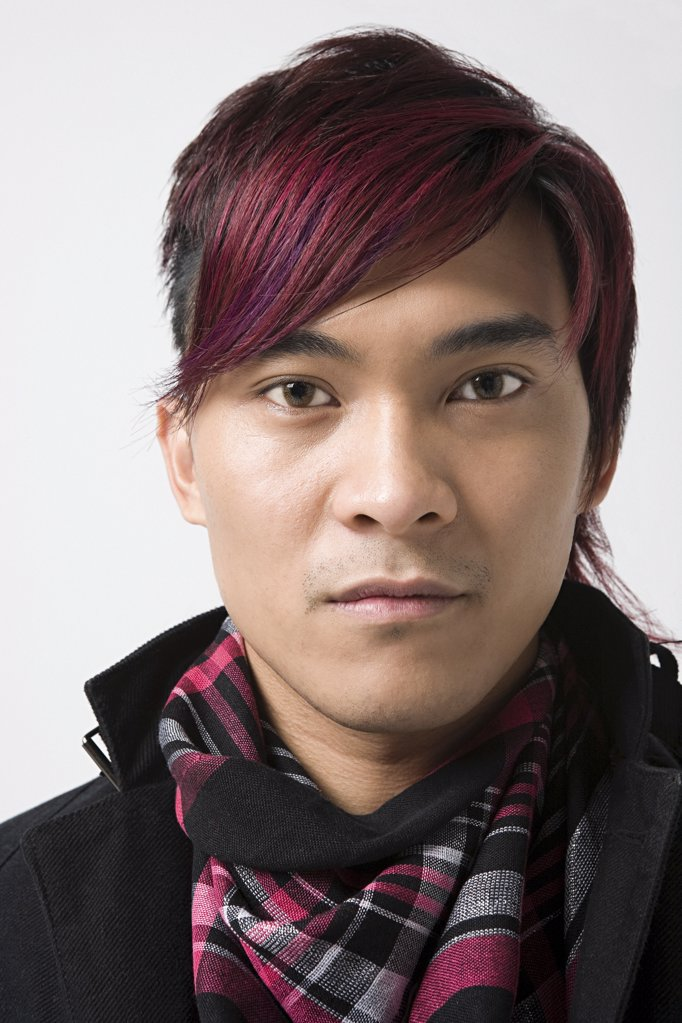Stock Photo: 1439R-1086885 Young japanese man with dyed hair