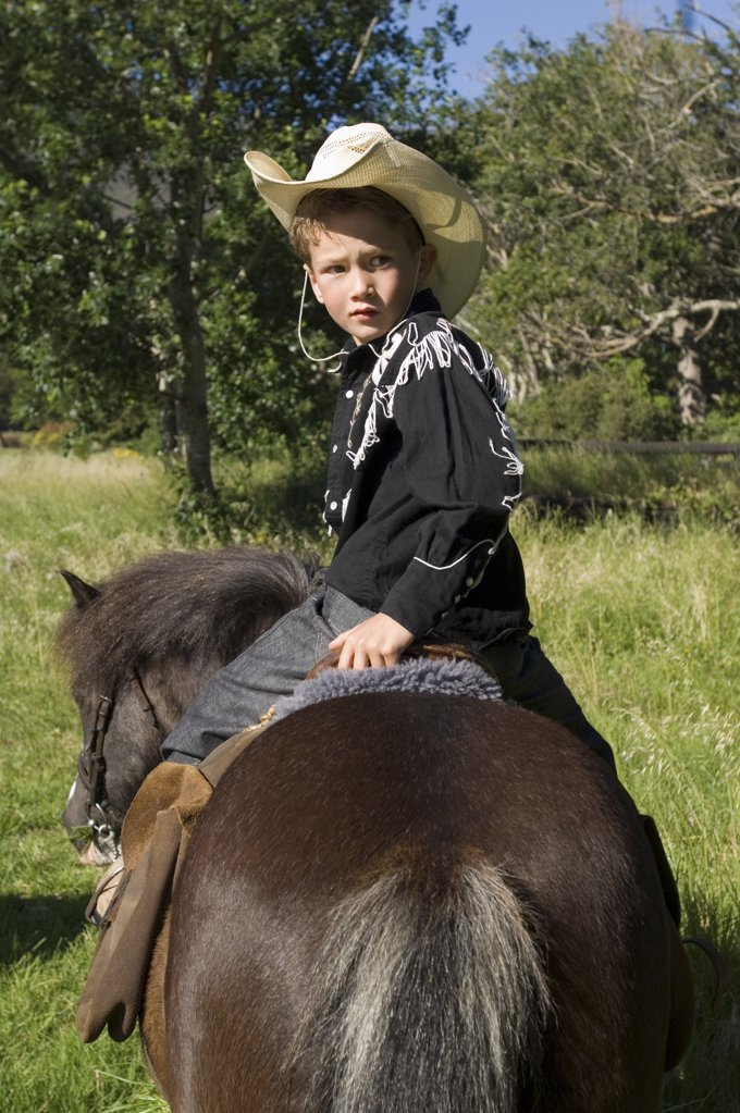 Stock Photo: 1439R-1086979 A boy riding a horse