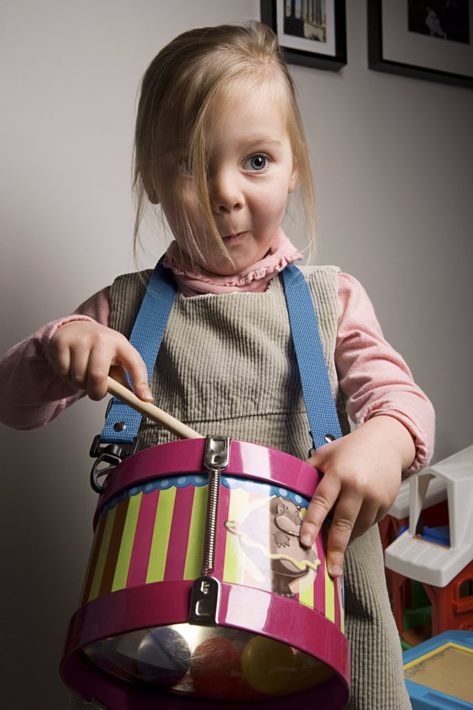 Girl playing a drum : Stock Photo