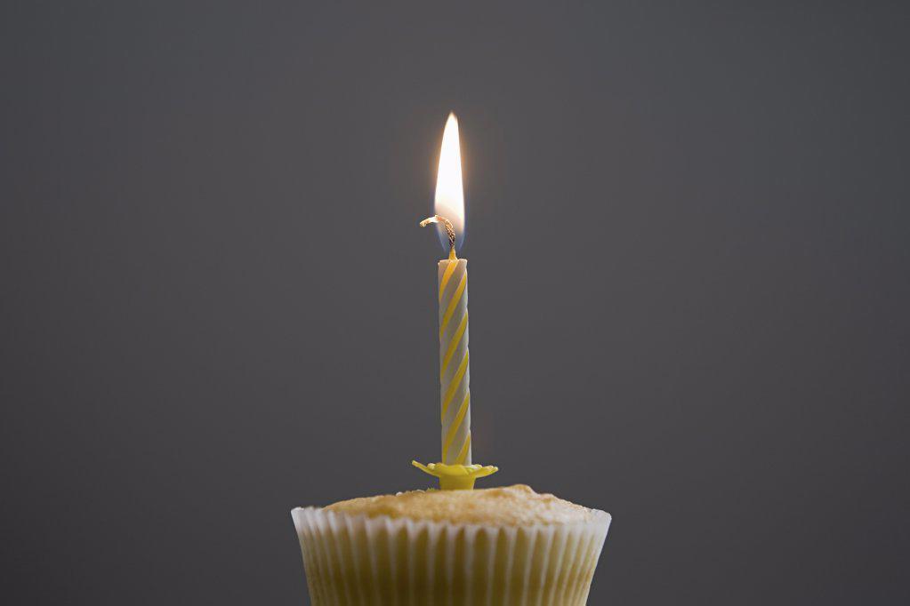 Stock Photo: 1439R-1088079 Birthday cupcake