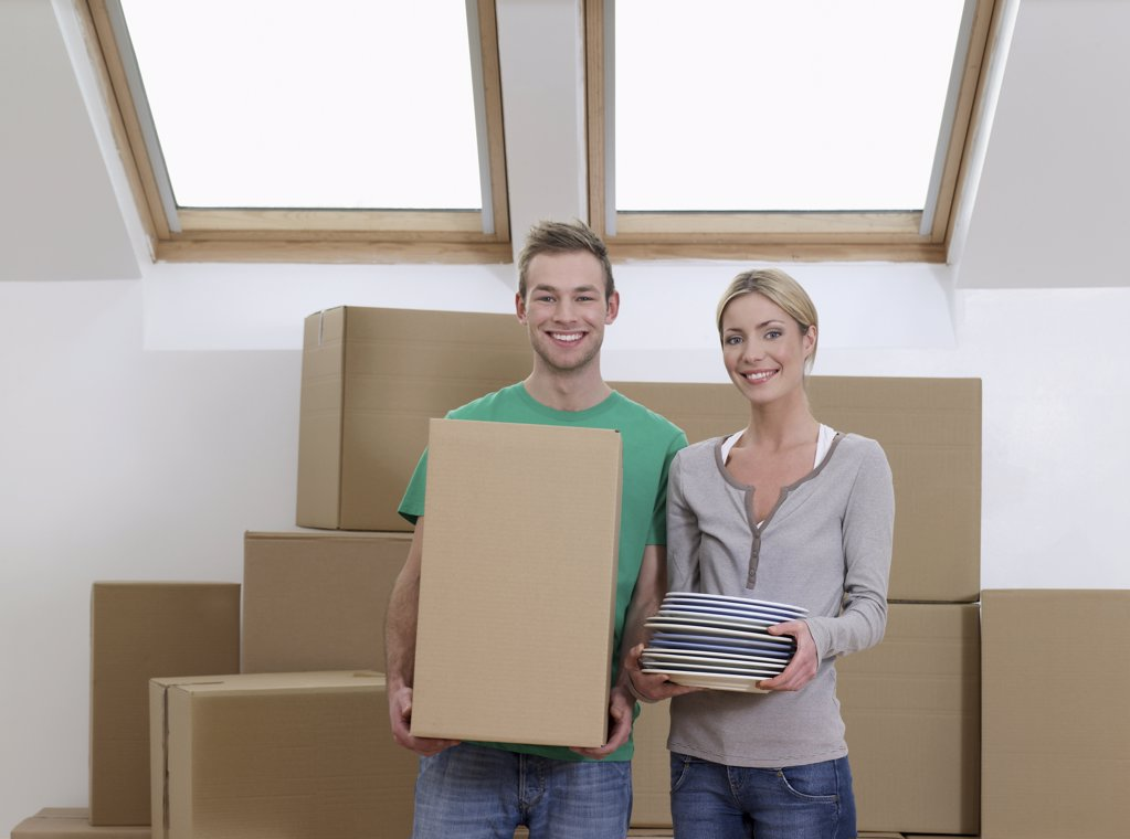 Portrait of a couple in their new home : Stock Photo