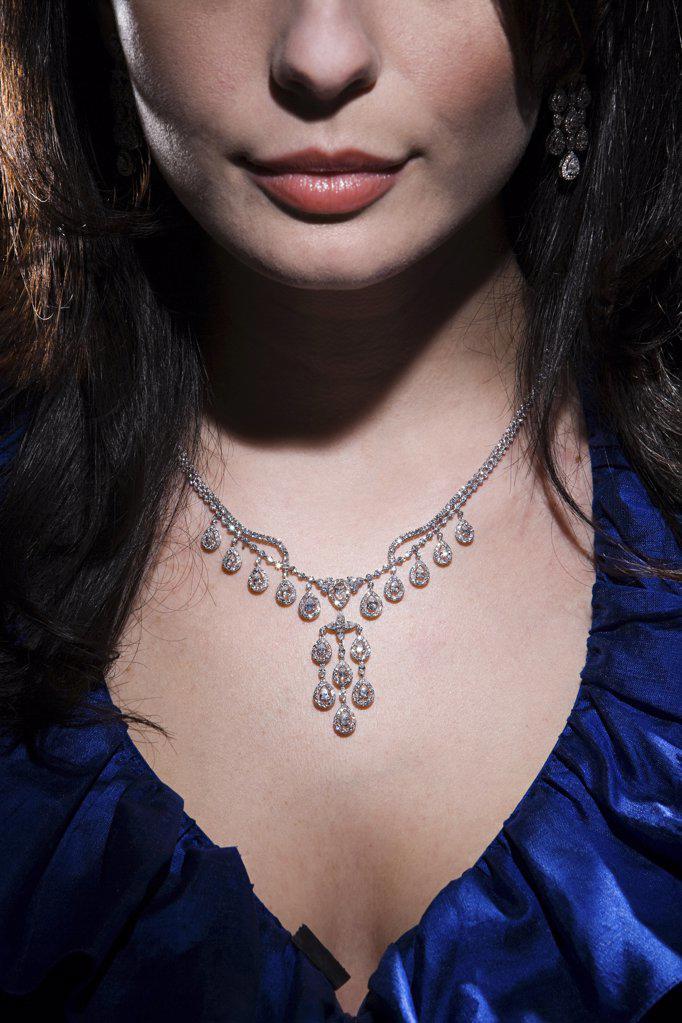 Woman wearing diamond necklace : Stock Photo