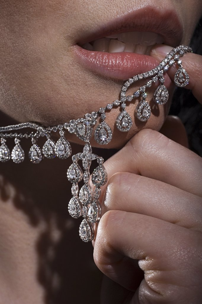 Stock Photo: 1439R-1088755 Woman with diamond necklace