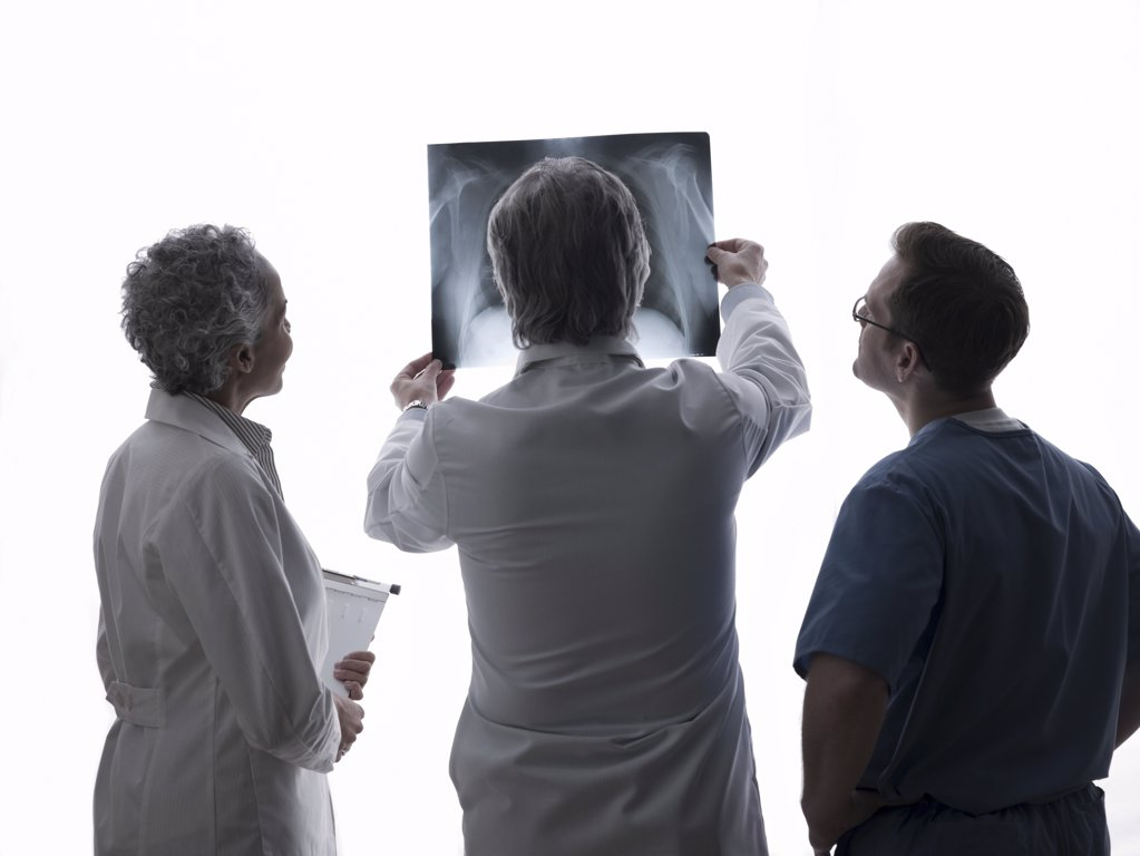 Stock Photo: 1439R-1090053 Doctors and surgeon looking at x-ray