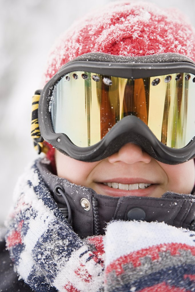 Stock Photo: 1439R-1090157 Boy wearing ski goggles