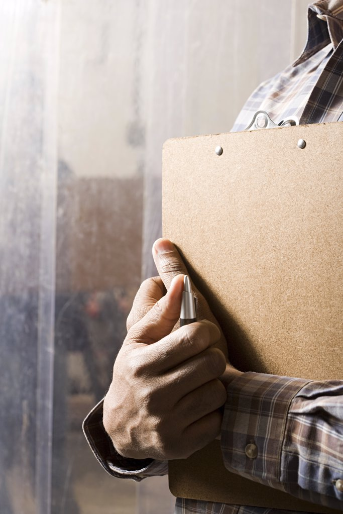 Stock Photo: 1439R-1090327 Man with clipboard
