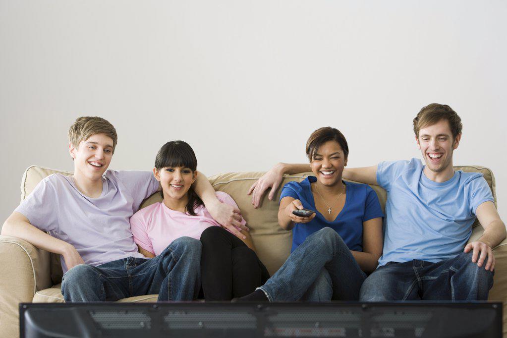 Stock Photo: 1439R-1090560 Friends watching tv