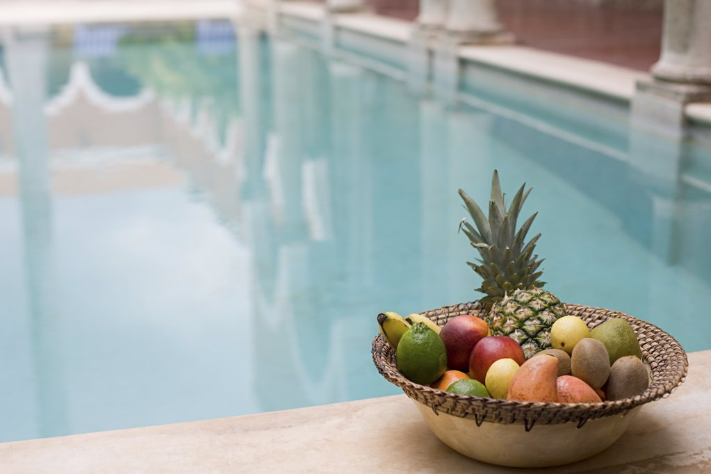 Fruit by swimming pool : Stock Photo