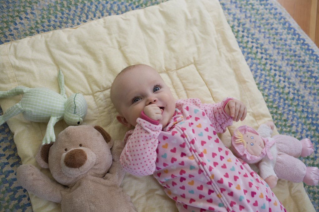 Baby with toys : Stock Photo