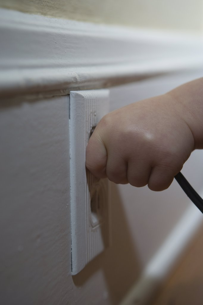 Child pulling plug : Stock Photo