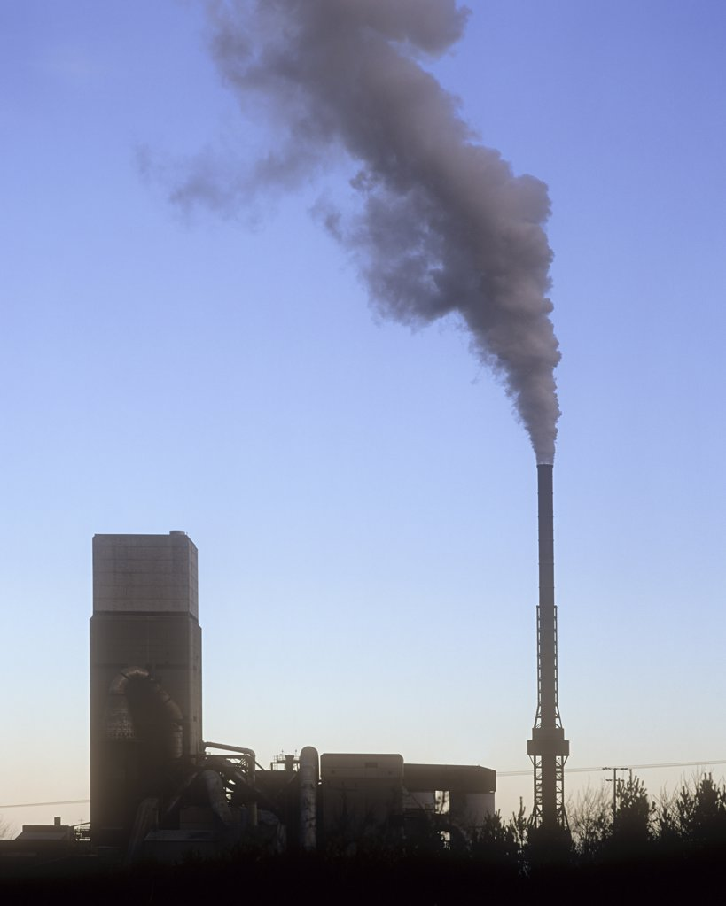 Stock Photo: 1439R-1092906 Smoke out of an industrial chimney