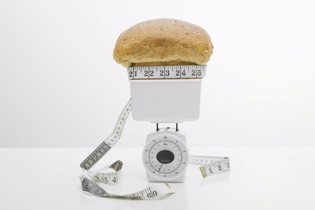 Stock Photo: 1439R-1093147 A loaf of bread on weight scales