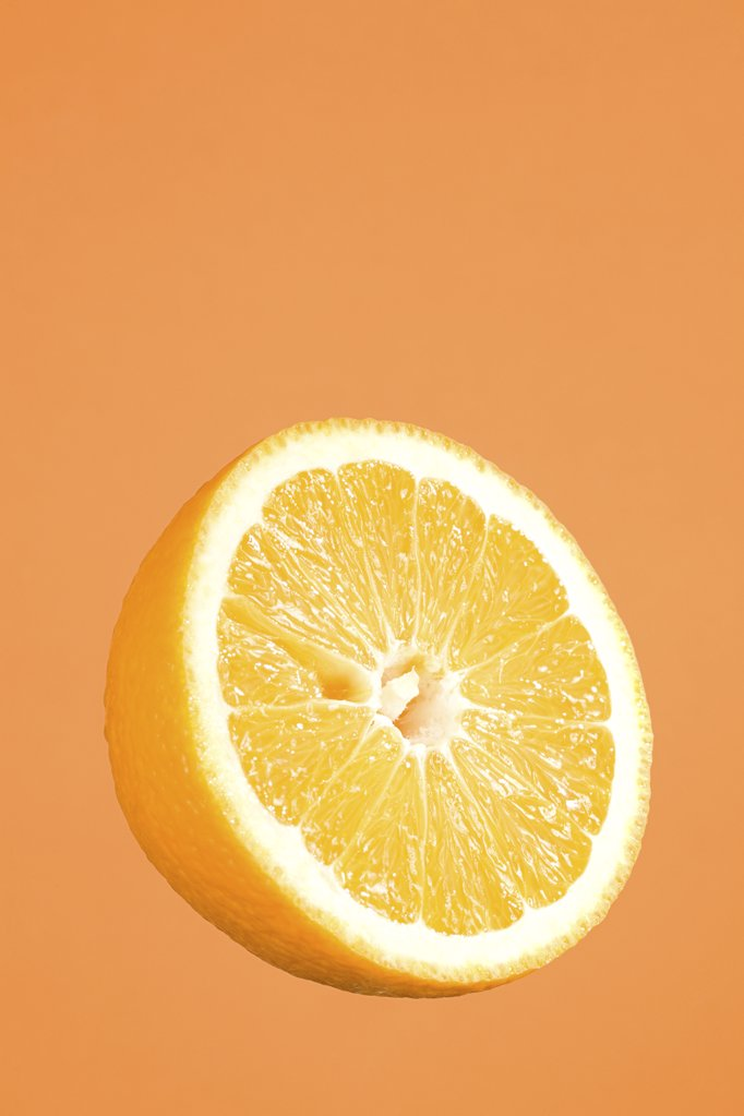Half an orange : Stock Photo