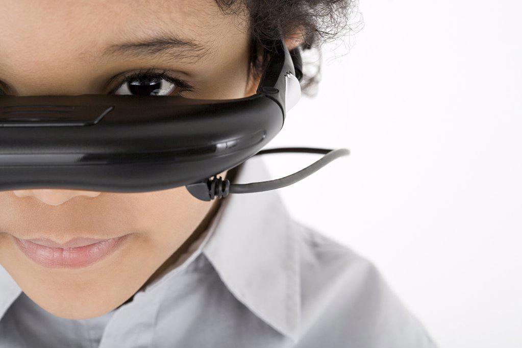 Boy wearing virtual reality headset : Stock Photo
