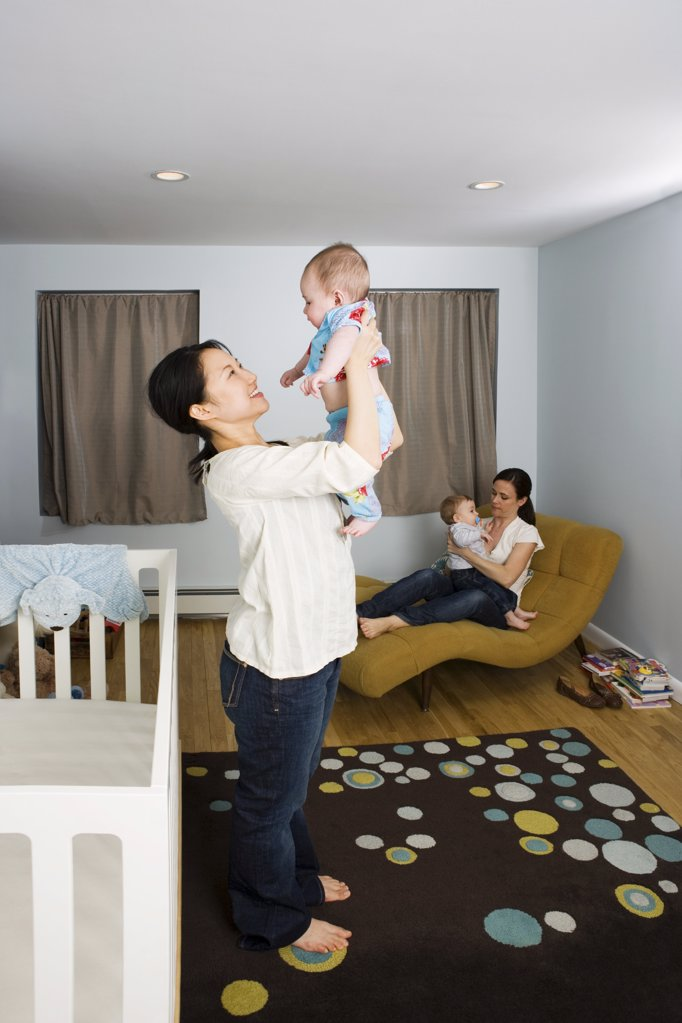 Mothers with their babies : Stock Photo